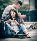 Teenage relaxing with mobile phones Stock Photo