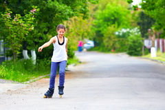 Teenage roller girl moving  the street Royalty Free Stock Photos