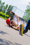 Teenage rollerblader taking a fall Stock Photography