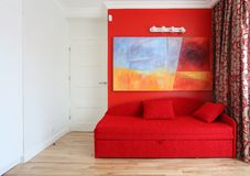 Teenage room. Red sofa and wall in teenage modern room Royalty Free Stock Photography