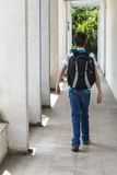 Teenage school boy with a backpack on his back walking to school Stock Images
