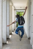 Teenage school boy with a backpack on his back walking to school Royalty Free Stock Photos