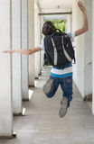Teenage school boy with a backpack on his back walking to school Royalty Free Stock Photo