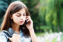 Teenage school girl calling Royalty Free Stock Images