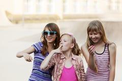 Happy teen girls walking in city street royalty free stock image