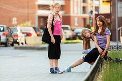 Teenage school girls on the city street Royalty Free Stock Photo
