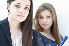 Teenage school girls looking at the camera Royalty Free Stock Photography