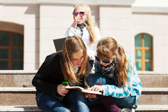 Teenage school girls on the steps of campus Royalty Free Stock Images