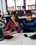 Teenage Schoolboy Pointing At Computer Monitor Royalty Free Stock Image