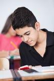 Teenage Schoolboy Text Messaging Stock Photo