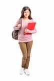 Teenage schoolgirl carrying backpack Stock Photography