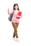 Teenage schoolgirl giving a thumb up Royalty Free Stock Images