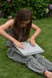 Teenage schoolgirl with notebook Royalty Free Stock Image