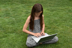 Teenage schoolgirl with notebook Stock Photo