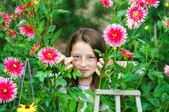 Teenage schoolgirl portrait with natural flowers Stock Images