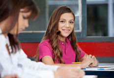 Teenage Schoolgirl Sitting With Female Friend In Royalty Free Stock Photo