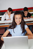 Teenage Schoolgirl Sitting With Laptop At Desk Royalty Free Stock Images