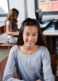 Teenage Schoolgirl Smiling In Computer Class Royalty Free Stock Images