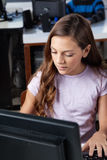 Teenage Schoolgirl Using Desktop Pc Stock Photo
