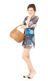 Teenage shopping girl with wicker basket Stock Photography