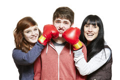 Teenage siblings fighting with boxing gloves. On white background Royalty Free Stock Photo