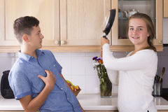 Teenage siblings having fight in kitchen Royalty Free Stock Photos