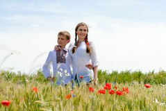 Teenage sister and little brother together on summer wheat fields Stock Photography