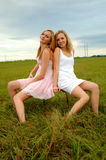 Teenage sisters in field royalty free stock images