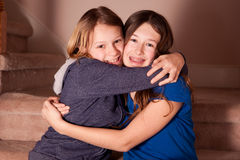 Teenage sisters hugging  Stock Image