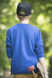 Teenage skateboard boy walking outdoor Stock Photos
