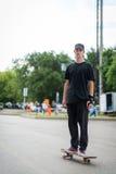Teenage skateboarder standing Royalty Free Stock Photo