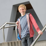 Teenage smiling student standing outside school Stock Photos