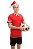Teenage soccer player with a Christmas hat Stock Photo
