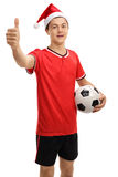 Teenage soccer player with christmas hat making thumb up sign Stock Image