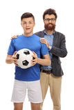 Teenage soccer player posing with his father Stock Image