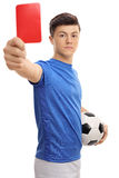 Teenage soccer player showing a red card Stock Photography