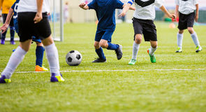 Teenage Soccer Players Playing Match on Sports Field Stock Photo