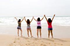 Teenage spirit. Spirited teenage girls having fun on the ocean Royalty Free Stock Photos