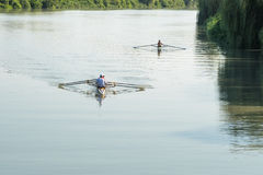 Teenage sportsmen in a boat, rowing on the river Rioni, Poti, Ge Stock Images