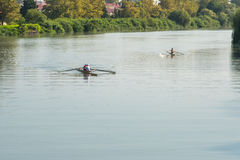Teenage sportsmen in a boat, rowing on the river Rioni, Poti, Ge Royalty Free Stock Photos