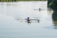 Teenage sportsmen in a boat, rowing on the river Rioni, Poti, Ge Stock Photography