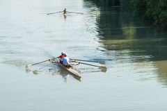 Teenage sportsmen in a boat, rowing on the river Rioni, Poti, Ge Stock Photo