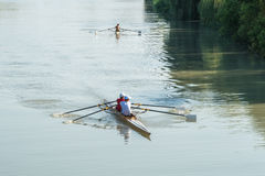 Teenage sportsmen in a boat, rowing on the river Rioni, Poti, Ge Stock Image