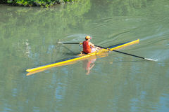 Teenage sportsmen in a boat, rowing on the river Rioni, Poti, Ge Royalty Free Stock Photo