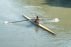 Teenage sportsmen in a boat, rowing on the river Rioni, Poti, Ge Royalty Free Stock Photography
