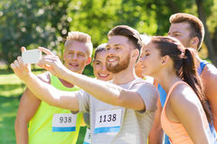 Teenage sportsmen taking selfie with smartphone Royalty Free Stock Images