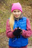 Teenage sporty girl listening to music outdoor. Stock Photography