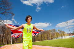 Teenage sprinter waving the flag of Great Britain Stock Image