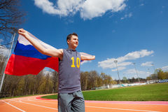 Teenage sprinter waving flag of Russian Federation Stock Photos