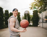 Teenage streetball player spinning the ball Royalty Free Stock Images